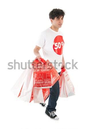 Gelukkig verkoop jonge man veel zakken papier Stockfoto © ivonnewierink