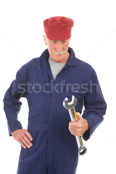 man in blue overall with wrench Stock photo © ivonnewierink