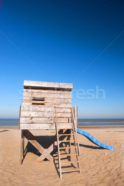 Tengerparti kunyhó fából készült kunyhó tájkép homok építészet Stock fotó © ivonnewierink