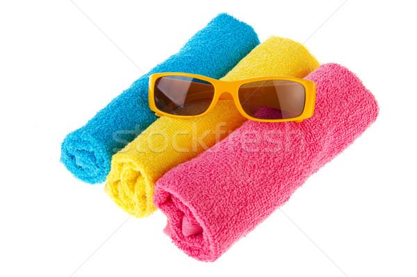 Roulé serviettes lunettes de soleil trois bleu jaune Photo stock © ivonnewierink