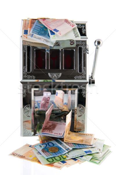 Játékautomata európai valuta pénz felirat siker Stock fotó © ivonnewierink