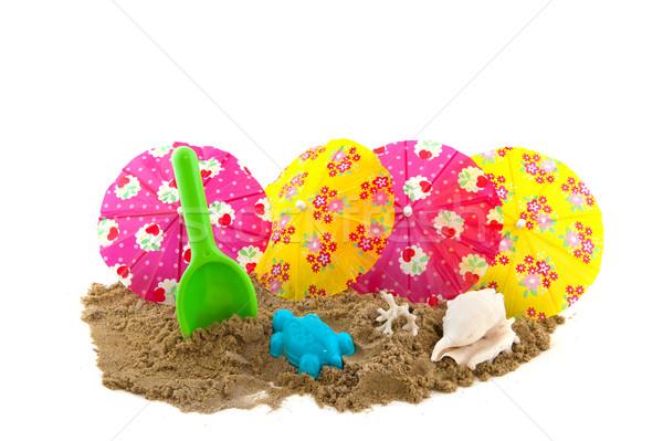 пляж игрушками снарядов бумаги песок тропические Сток-фото © ivonnewierink