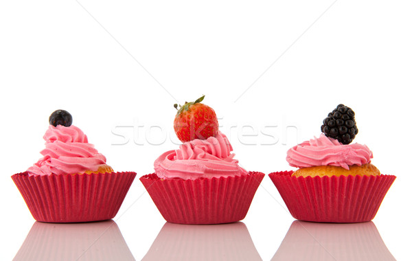 Fruit cupcakes with pink buttercream Stock photo © ivonnewierink