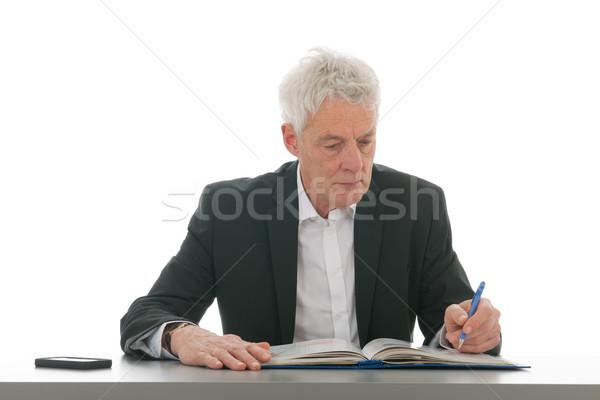 Uomo d'affari lettura manuale ufficio uomo matita Foto d'archivio © ivonnewierink