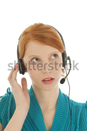 Young red haired woman with head set Stock photo © ivonnewierink