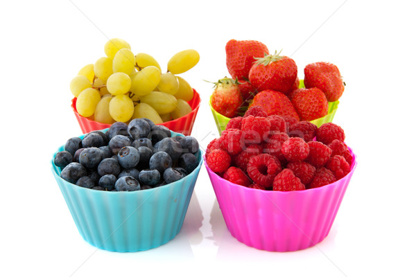 Fresh fruit in colorful cups Stock photo © ivonnewierink