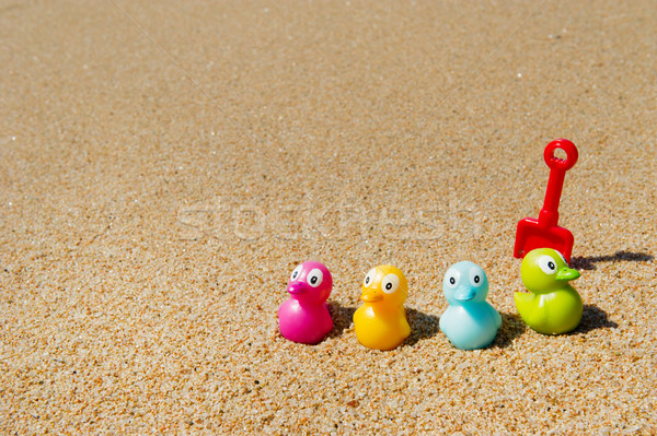 Colorful toy ducks  at beach Stock photo © ivonnewierink