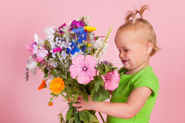 Toddler girl with flowers Stock photo © ivonnewierink