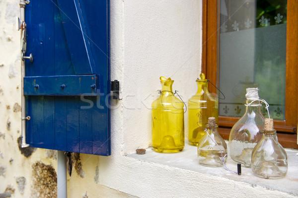 Old glass bottles in window Stock photo © ivonnewierink