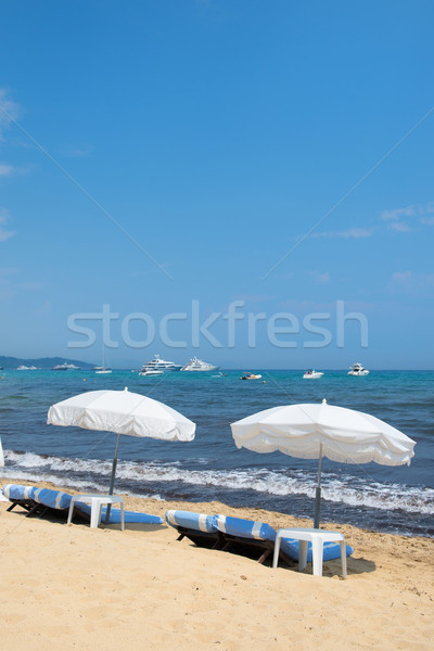 Beach with parasols and beds Stock photo © ivonnewierink