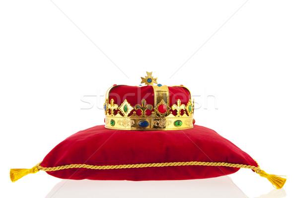 Or couronne velours oreiller rouge fond Photo stock © ivonnewierink