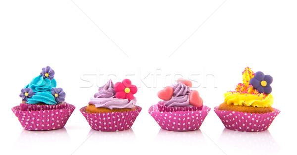 Lila rózsaszín minitorták vajkrém virágok otthon Stock fotó © ivonnewierink