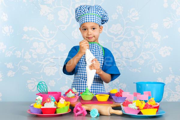 Little boy baking cupcakes Stock photo © ivonnewierink
