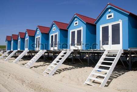 Blue beach-houses Stock photo © ivonnewierink