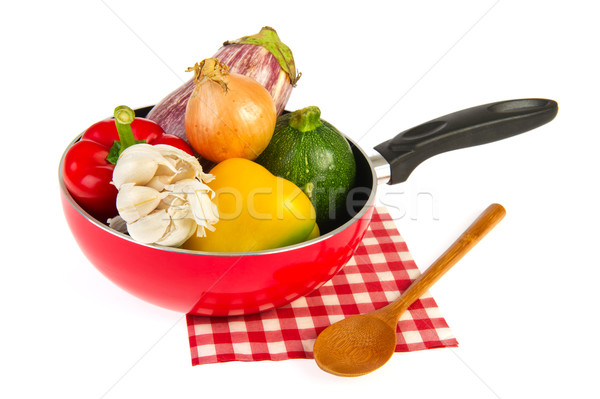 Red frying pan with ratatouille vegetables Stock photo © ivonnewierink