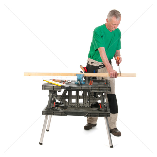 Construction worker sawing a shelf Stock photo © ivonnewierink