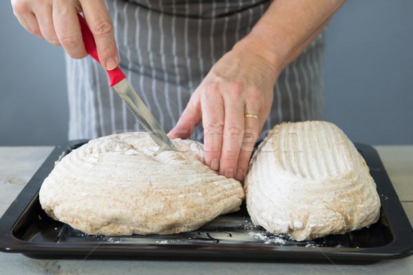 Scoring bread dough Stock photo © ivonnewierink