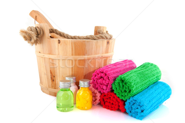 Wooden sauna bucket with colorful towels and soap Stock photo © ivonnewierink