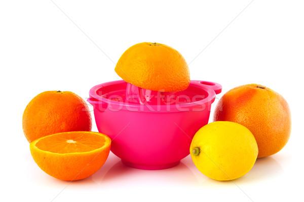 Citrus fruit sinaasappelen citroen roze plastic Stockfoto © ivonnewierink