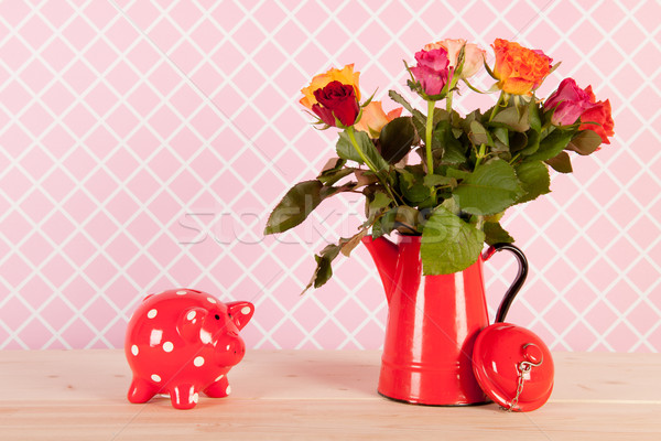 Colorful bouquet roses and piggy bank Stock photo © ivonnewierink
