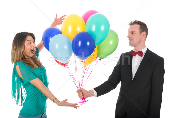 Young man giving balloons to girl friend Stock photo © ivonnewierink