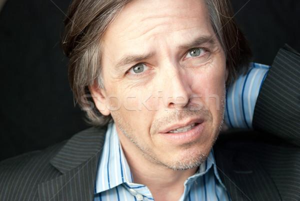 Worried Businessman Rubs Neck Stock photo © jackethead