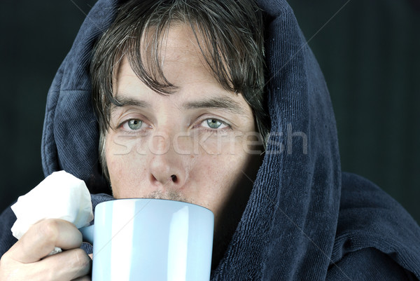 Sick Man With Tissue Drinking From Mug Stock photo © jackethead