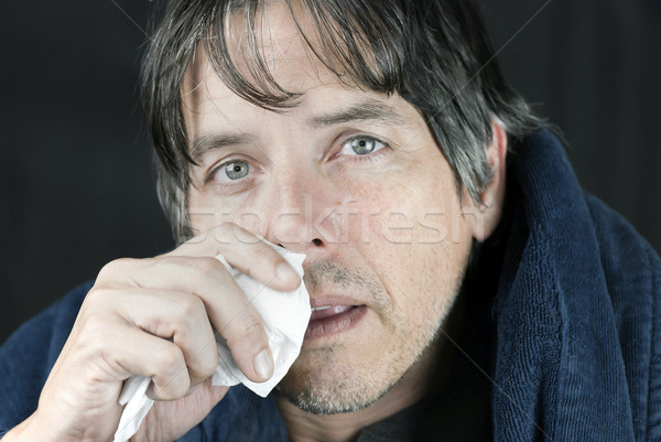 Sick Man In Housecoat With Tissue Stock photo © jackethead