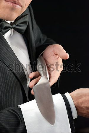 Fine Dining Waiter Presenting Knife Stock photo © jackethead