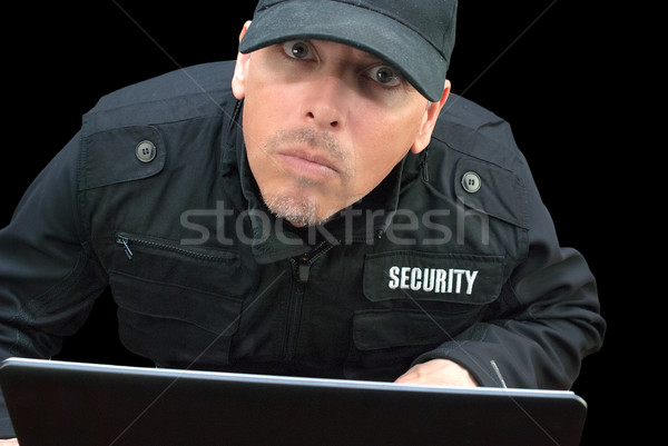 Security Working On Laptop, Looking To Camera Stock photo © jackethead