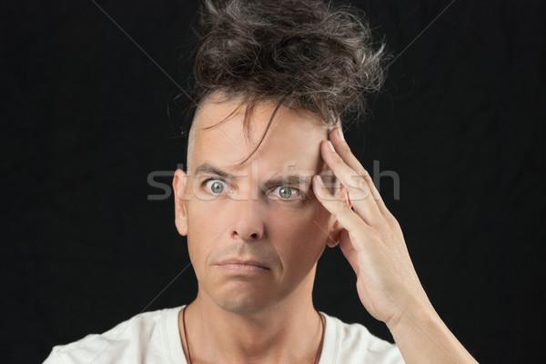 Man Thinks, Looking Off Camera, Hair Piled On Head Stock photo © jackethead