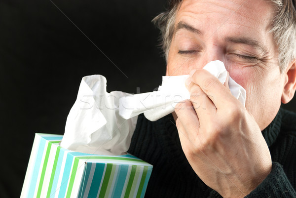 Man Blows Nose Stock photo © jackethead