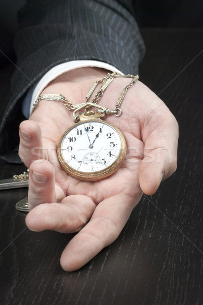 Businessman Displying Pocketwatch Stock photo © jackethead