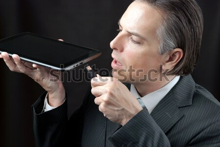 Stockfoto: Zakenman · tablet · knuffelen · business · technologie