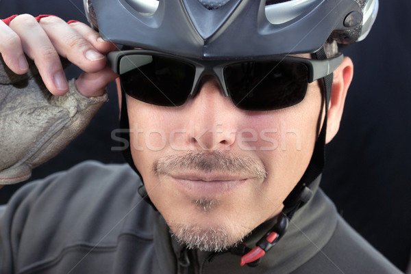 Friendly Bicycle Courier Puts On Sunglasses Stock photo © jackethead