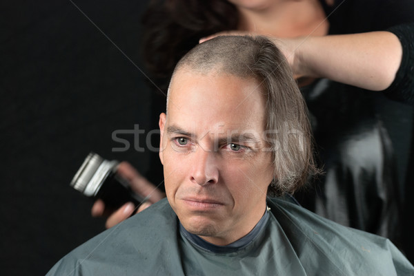 Mourning Man Getting Long Hair Shaved Off For Cancer Fundraiser Stock photo © jackethead