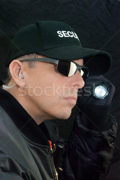 Security Guard Searches With Flashlight Stock photo © jackethead