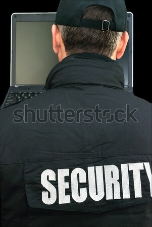 Security Working On Laptop, Over The Shoulder Stock photo © jackethead