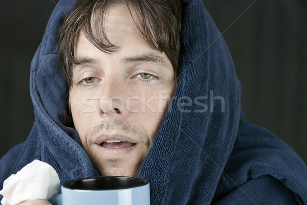Sick Man Holding Mug Stock photo © jackethead