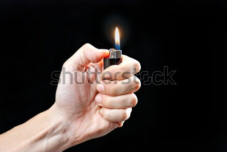 Main briquet feu homme Photo stock © jackethead