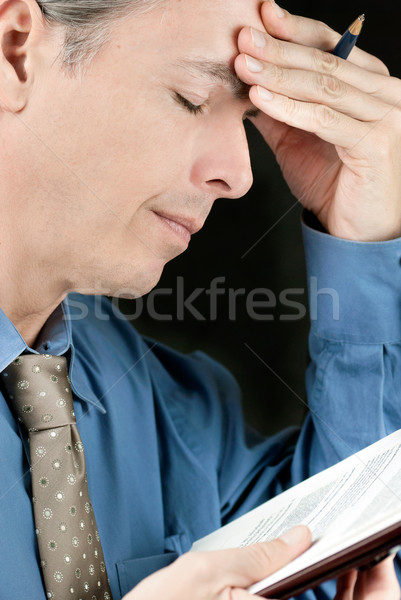 Stressed Businessman Rubs Forehead Stock photo © jackethead