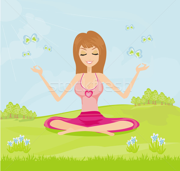 girl sits and meditates in the park Stock photo © JackyBrown