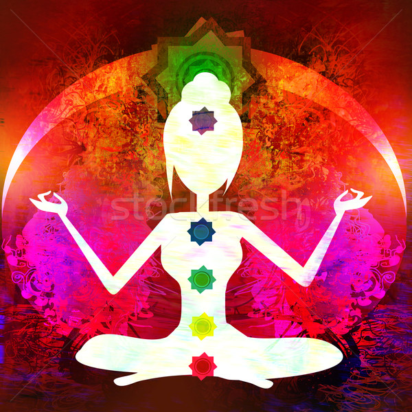 Yoga lotus pose. Padmasana with colored chakra points.  Stock photo © JackyBrown