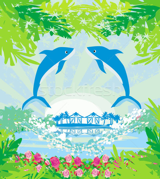 Tropical island paradise with leaping dolphins Stock photo © JackyBrown