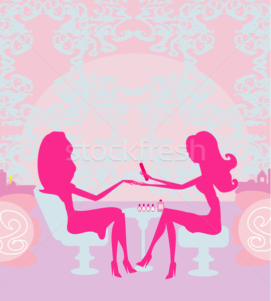Young lady doing manicure in beauty salon  Stock photo © JackyBrown