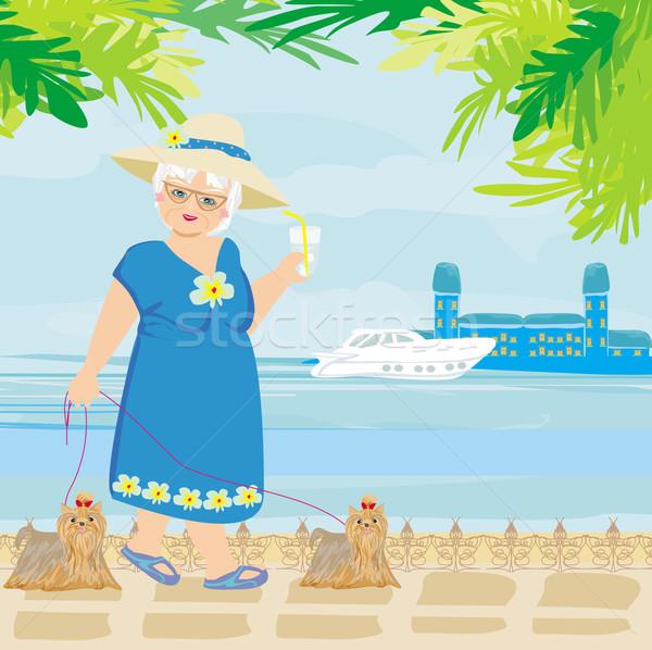 elegant senior woman on vacation in the tropics Stock photo © JackyBrown