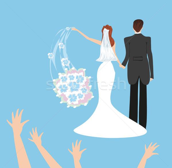 wedding couple, bride throws her wedding bouquet Stock photo © JackyBrown