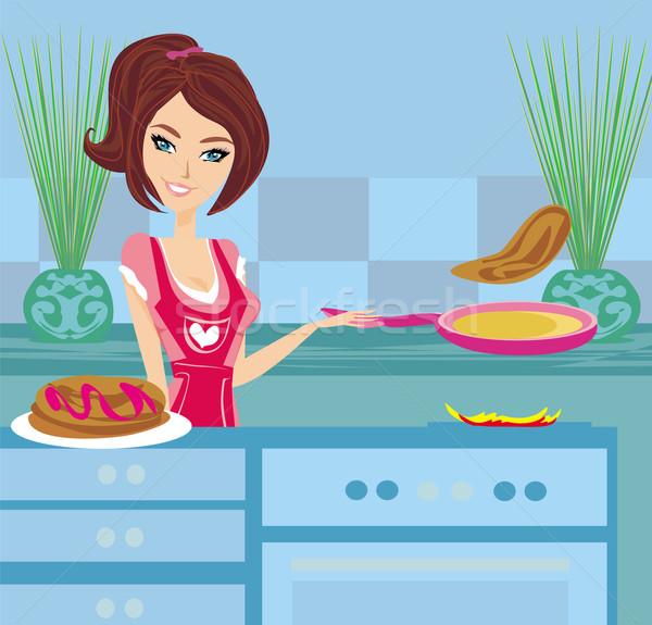 Femme tablier poêle fleurs alimentaire cuisine Photo stock © JackyBrown
