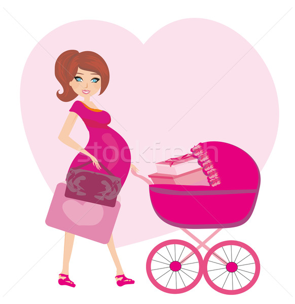 pregnant woman with a pink baby carrier full of presents Stock photo © JackyBrown