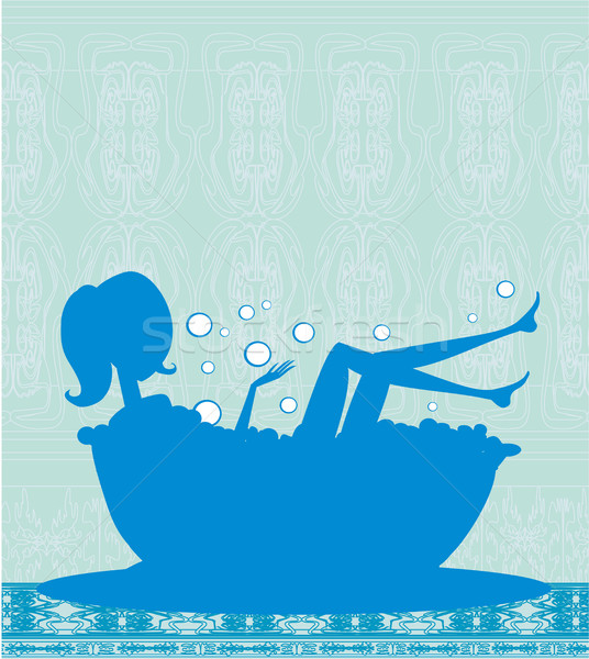 Girl relaxes in the bath Stock photo © JackyBrown